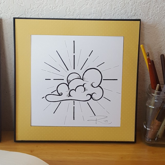 Woodblock-inspired illustration of the sun shining from behind a cloud. Ink on paper.