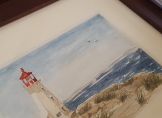 Watercolor painting by Renee McAdam of the Peggy's Cove lighthouse in Nova Scotia.