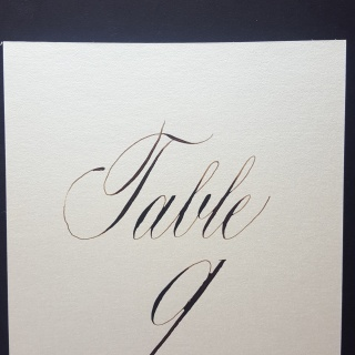 Table number card written in calligraphy by Case Sensitive Designs LLC